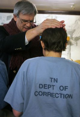 Nashville Area Bishop William T. McAlilly baptizes an inmate during the same service in which Grace Place was chartered as a United Methodist church.