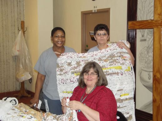 The Rev. Diane Harrison (seated) and two of her parishioners display handmade items members of Grace Place United Methodist Church make and sell to raise money for mission – and a tithe to the Memphis Conference.