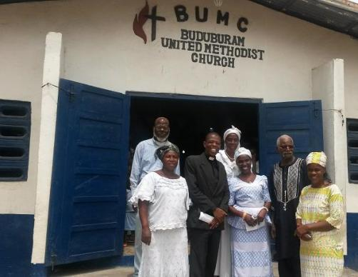 The Rev. James Kaifunbah poses with the leadership team of Buduburam United Methodist Church.
