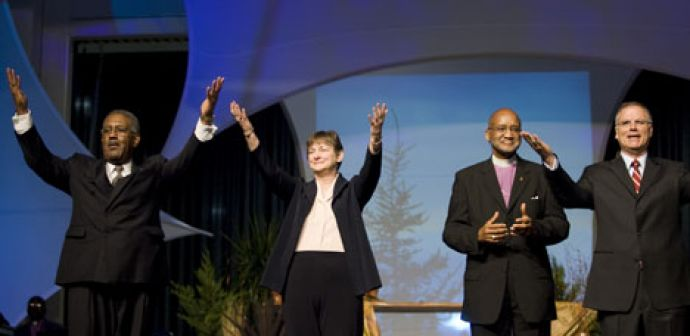 United Methodist agency leaders celebrate following their April 24 address on the four new areas of focus for the denomination during the 2008 United Methodist General Conference in Fort Worth, Texas. Standing (from left) are the Rev. Jerome King Del Pino, the Rev. Karen Greenwaldt, Bishop Felton May and the Rev. Larry Hollon.