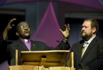 Donald Reasoner (right) translates into English the sermon of Bishop João Somane Machado of Mozambique at an April 25 worship service during the 2008 United Methodist General Conference. Reasoner works for the church's Board of Global Ministries.