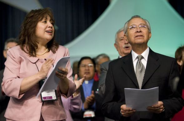 Bishops Minerva Carcaño and Elias Galván sing prior to a discussion on the relationships between United Methodist churches in the United States and their counterparts in Latin America during the 2008 United Methodist General Conference in Fort Worth, Texas.