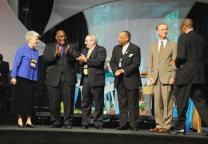 Bishop Ernest Lyght (right) congratulates the new leadership team for the United Methodist Council of Bishops: (from left) Bishops Sharon Rader, Gregory Vaughn Palmer, Larry M. Goodpaster, Robert E. Hayes and Donald A. Ott.