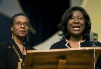 Bishop Linda Lee (left) and Erin Hawkins lead the celebration of the 40th anniversary of the United Methodist Commission on Religion and Race at 2008 General Conference.