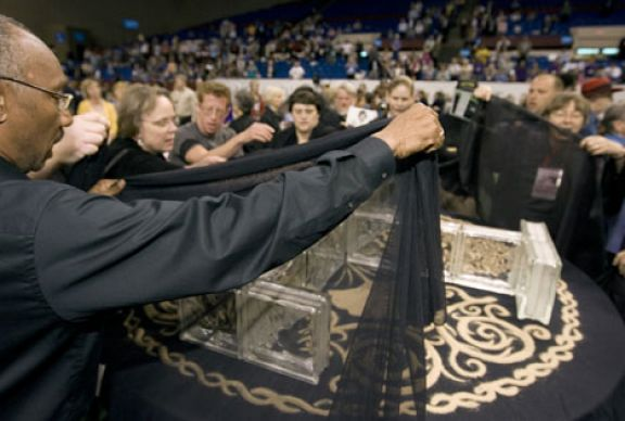 Supporters of full inclusion for gays and lesbians in The United Methodist Church drape the central table in black cloth during a demonstration on the floor of the 2008 United Methodist General Conference in Fort Worth, Texas.