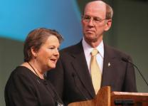 Bishops Mary Ann Swenson and John Hopkins introduce the presentation on the church's proposed four-year budget of $642 million. The spending plan later was approved by the 2008 United Methodist General Conference.