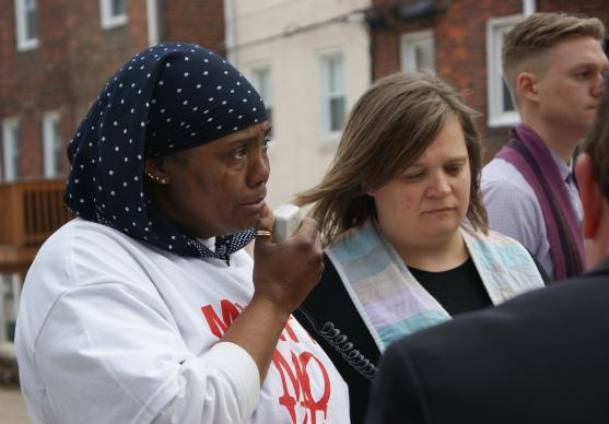 Movita Johnson-Harrell, who lost her son and nephew to gun murder, speaks during the Good Friday Memorial to the Lost walk in Philadelphia, sponsored by Heeding God's Call to End Gun Violence, an ecumenical faith-group which includes United Methodists.