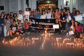 More than 100 people joined the vigil in front of the Central United Methodist Church on April 3, to pray for farmers and Lumads who were asking for rice and protesting treatment from the government. Photo courtesy of Gladys P. Mangiduyos, UMNS.