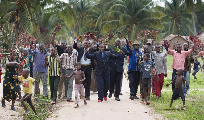 The Rev. Nyenda Okoko (center) leads a procession to welcome visitors to Oye United Methodist Church, south of Kindu, Democratic Republic of Congo. General Conference 2016, set for May 10-20 in Portland, Oregon, will consider when to add bishops in Africa. Photo by Mike DuBose, UMNS