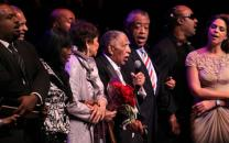 The Rev. Joseph E. Lowery (with microphone) leads the singing of