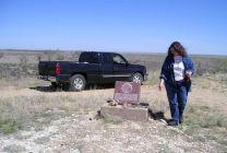 The Rev. Carol Lakota Eastin views the marker at the Sand Creek Massacre National Historic Site near Chivington, Colo. A UMNS photo by Eliida Lakota.