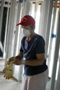Phyllis Fissel, 77, prepares to install insulation in a home in New Orleans. A UMNS photo by Kathy L. Gilbert.