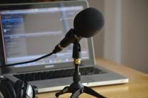 Podcasting setup with microphone and computer. Image by Nicolas Solop, Flickr.com.