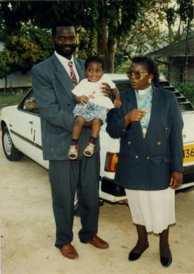 Tafadzwa (left) and the Rev. Ever Mudambanuki pose with their toddler son, Wesley.