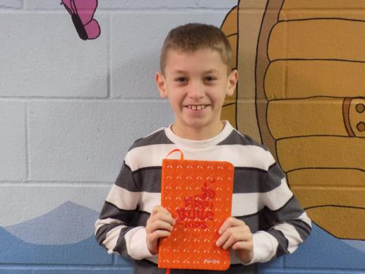 Fourth-grader Colyn Chris regularly brings his new Bible to Sunday school at Faith United Methodist Church in Goshen, Ind.