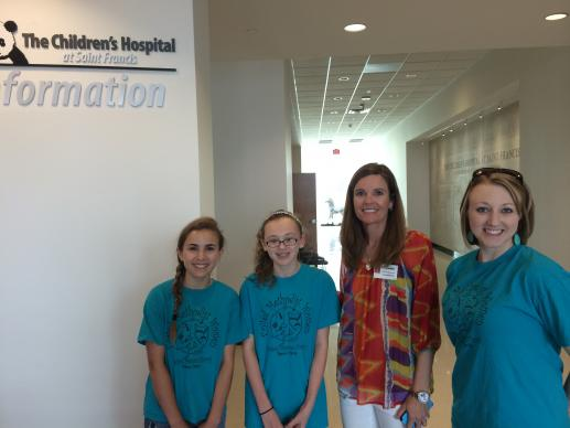 Eighth-grade members of the United Methodist Women Peace Circle at Boston Avenue United Methodist Church in Tulsa tour a children's hospital for which they collected and donated coloring books and other art supplies.