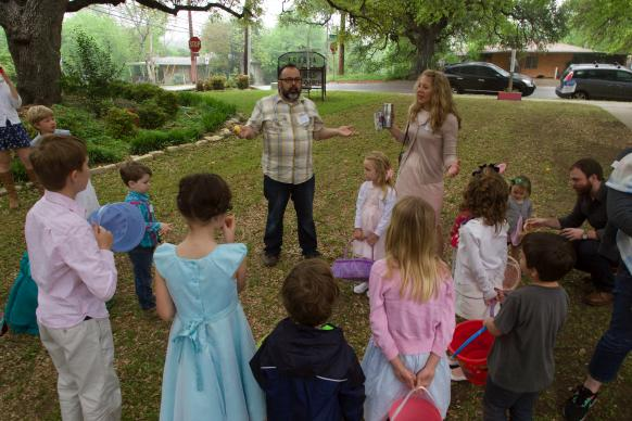 The Rev. Eric Vogt amps up the kids for the 2015 Easter egg hunt at Servant Church.