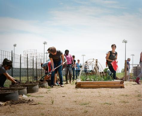 Servant Church volunteers work in the Del Valle High School garden.