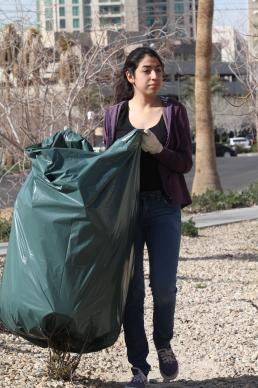 Impact Las Vegas 2013 volunteer Carla Sarmiento carries a bag of debris. She was among  more than 500 volunteers who left the TED-style talks, worship and small groups of the Relevance X 2013 young adult leadership conference to spend a morning serving in the Palos Verdes neighborhood in Las Vegas.