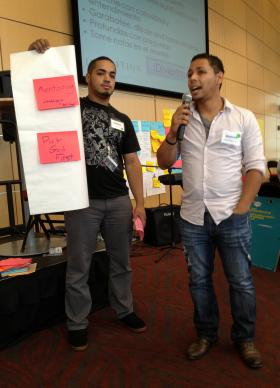 Alexis Soto (left) and Freddie Bermudez share reflections on the church and future generations during the 2013 MARCHA caucus in Boston.