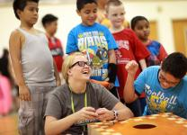 Intern Challye Hays laughs with children as they play during a  Project Transformation Family Fun Night at Antioch (Tennessee) United Methodist Church. Project Transformation is among the recepients of Young Clergy Initiative grants.