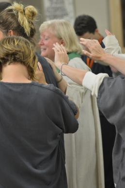 The Rev. Lee Schott leads prayer for an inmate during worship at Women at the Well United Methodist Church inside the Iowa  Correctional Facility for Women
