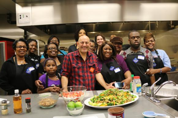 "Better Community Development, Inc. in Little Rock, Arkansas, partnered with the Arkansas Hunger Alliance to provide a cooking class, ""Cooking Matters.""  The Food Network Channel's Simon Majumdar (center) taught cooking techniques to participants learining how to eat healthy, delicious meals on a budget."