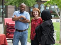 The Rev. Erica Allen (center) welcomes Keith Wright (left) and the Rev. Toi King to worship at East Bank Church, a new church start meeting in the East Park Community Center in Nashville, Tennessee.
