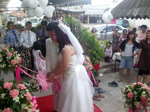 Jurirat and Sompap are married in 2010 in the first wedding at the Bowin United Methodist Church near Bangkok, Thailand.