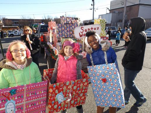 Grace Callwood (right) and her friends Alexis Bell (left) and Sarah Beall led the We Cancerve float in her community's Christmas parade in early December.