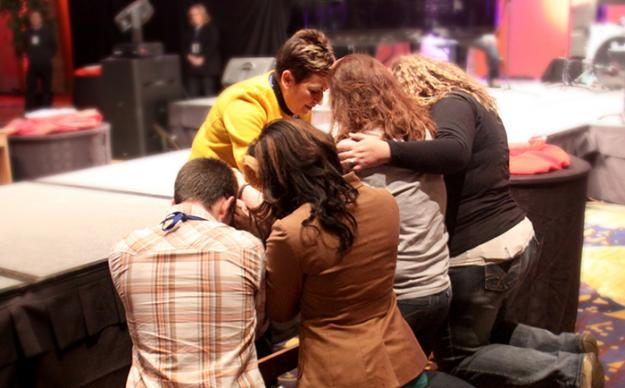 Louisiana Bishop Cynthia Fierro Harvey prays with young adults considering God's call to ordained ministry during Exploration 2013 in Denver.