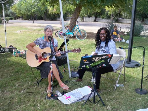 Guitarist Susan Daicoff and singer Cheryl Metcalfe, both members of CrossRoads United Methodist Church, Phoenix, entertain at a local farmer's market.