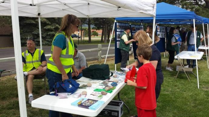 Volunteers from Tri-Lakes United Methodist Church in Monument, Colo., pass out preparedness information during  a community FireWise fair.