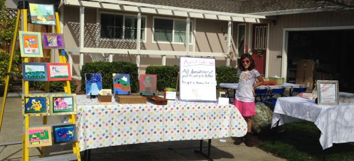 Fourth-grader Faith Watters sells lemonade and art work to support the efforts of her Sunday school class to buy a llama. She is from Los Altos United Methodist Church in California.
