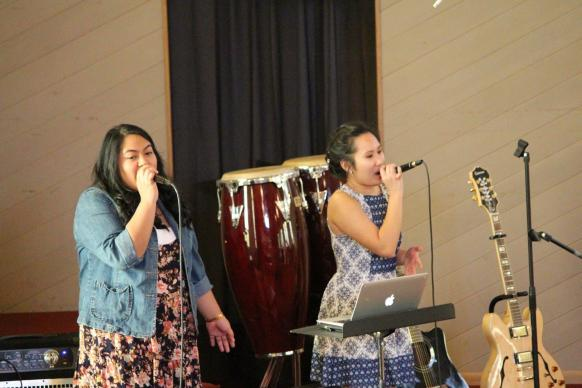 Isabella Tinte (right) and Hazel Rollolazo are part of the worship team at Beacon United Methodist Church in Seattle.