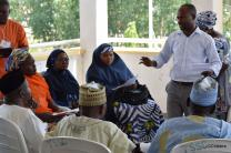 The Rev. Ande Emmanuel speaks to participants in a seminar to increase understanding between Christians and Muslims in Nigeria. Listening are (from left) Eunice B. Bill, McBride United Methodist Church, Jalingo, and Sharp M. Hassan and Sadiya Umar Mafiosi of the Federation of Muslim Women.