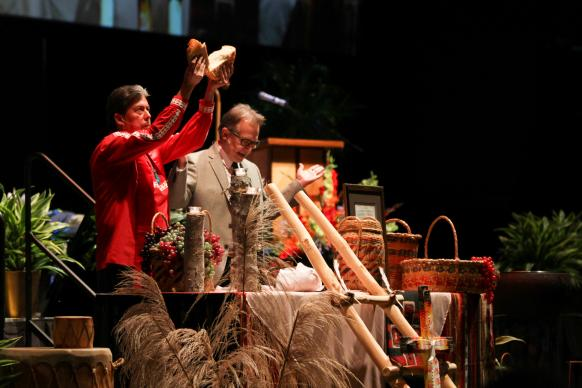 The Rev. David M. Wilson (left) of the Oklahoma Indian Missionary Conference and Bishop Gary Mueller preside over Holy Communion as part of the 2015 Arkansas Annual Conference's Service of Repentance and Reconciliation toward Indigenous People. The gathering was held in Hot Springs, Arkansas, where centuries ago, native tribes laid down their weapons so everyone could partake of the healing waters. Learning about the acts of repentance in which United Methodists have engaged since 2012 is one way to observe Native American Ministries Sunday.