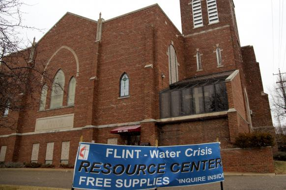 Signs in English and Spanish identify the Water Resource Center at Asbury United Methodist Church in Flint, Michigan. Asbury is one of eight churches providing filters, test kits and other supplies.