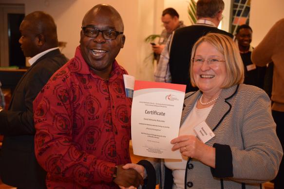 David Ndinashe Makumbe receives a certificate for