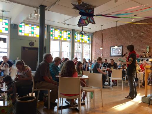 Preaching to the congregation of Urban Abbey, a United Methodist congregation meeting in a coffee shop in Omaha, Nebraska, is the Rev. Debra McKnight.