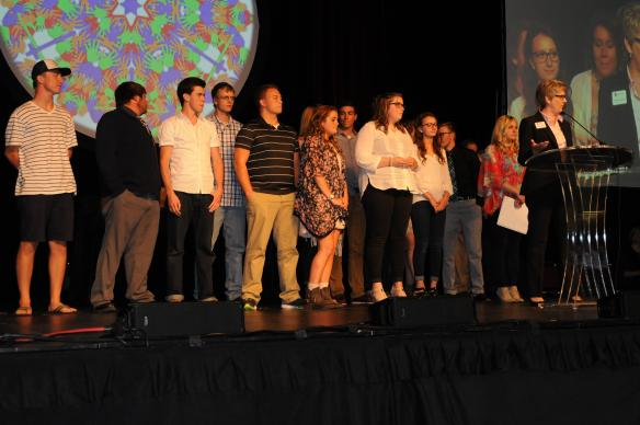 Youth and their leaders from Hastings United Methodist Church gather onstage during the Minnesota Annual Conference. Their church received the 2015 Culture of the Call Award from the Foundation for Evangelism.