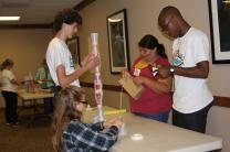 (From left) Allison Walkley, Andrew Post, Bethany Printup-Davis and Weagba Nelson do a team-building activity during a session for participants in the Upper New York Young Clergy Initiative project.