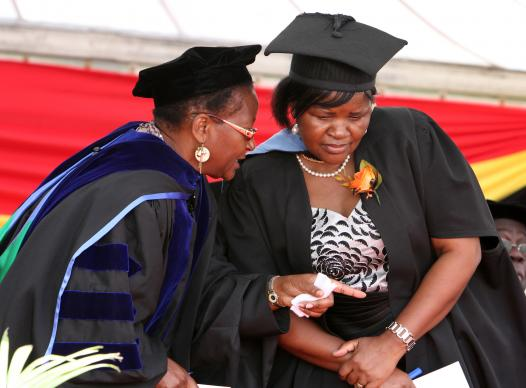 The Rev. Beauty Maenzanise (left), dean of the faculty of theology of Africa University, speaks with Clara Masiyazi, deputy registrar, during the 20th anniversary celebration of Africa University in 2013.