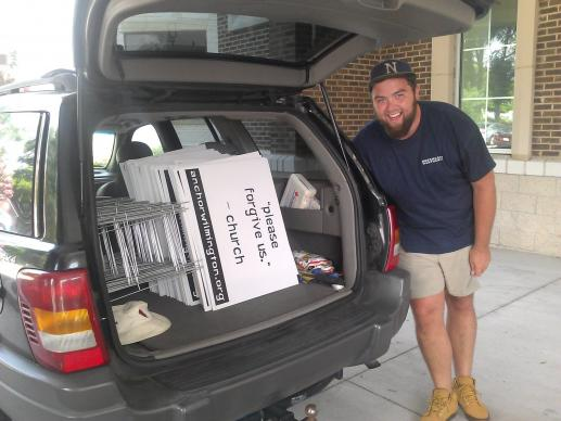 Ross Johnson helps post signs around the city of Wilmington, North Carolina, as an outreach from Anchor Church. A second-year seminary student, Johnson did his field education for Duke Divinity School at Anchor Church this summer.