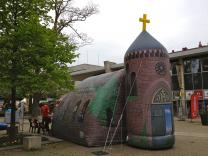 The inflatable church draws in curious visitors of all types – even secular Europeans who've never set foot in a church.