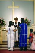 The Rev. Sandy Sakarapanee conducts a wedding for two members of the Golden Triangle Fellowship at Belmont United Methodist Church in Nashville, Tennessee. Many in the fellowship are refugees from the civil war in Burma, now called Myanmar.