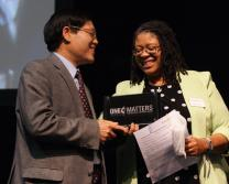 The Rev. Zhaodeng Peng receives the One Matters Discipleship Award from Cheryl Walker of the Discipleship Ministries' staff during the New York Annual Conference.