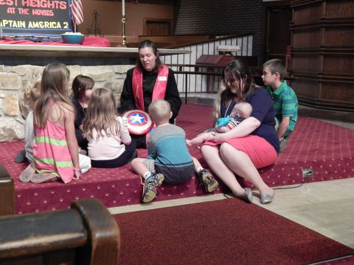 The Rev. Andrea Beyer, a commissioned elder, leads children's time in worship at West Heights United Methodist Church in Wichita, Kan.
