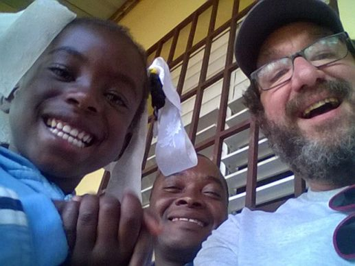 The Rev. Nick Nicholas (right) laughs with some of his friends during a Volunteers in Mission trip to Haiti.