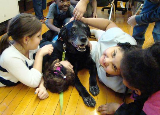Dare, a black Labrador, finds new friends through Paws and Play at Jefferson Elementary School in Wichita, Kansas. Photo courtesy of East Heights United Methodist Church.